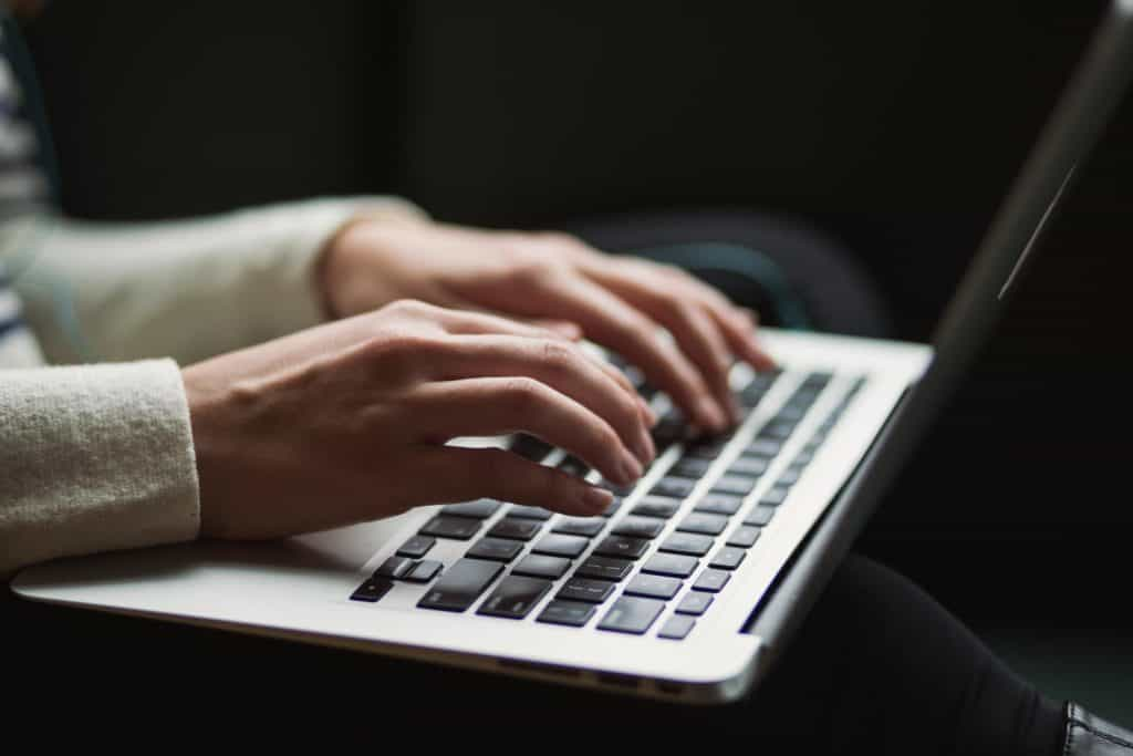 typing on a laptop keyboard Reasons Why You Should Use a VPN